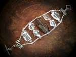 Grey faceted acrylic bead bracelet with rock crystal accents